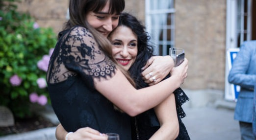Two Alumni hugging in the quad at Goodenough College