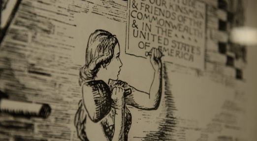 Drawing of woman nailing a post to a wall