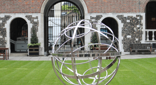 Globe sculpture with College motto in the Quad in London House